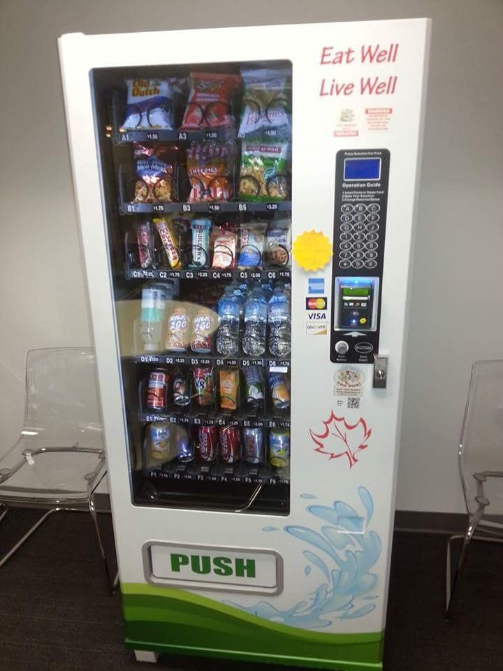 combo vending machine contains both pop and snacks